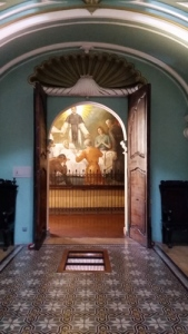 Looking ftom his chapel to a fresco of one of his miracles