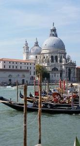 Saint Mary of Health Church and gondolas. Venice, Italy.