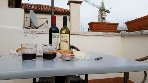 Dinner from the grocery store. Rooftop terrace. Venice. Italy.